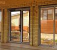 Алюминиевая дверь в частном доме
